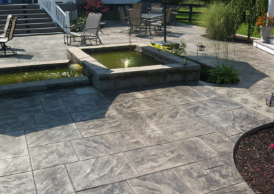 Ashlar Slate Patio with Custom Pond and Flower Beds