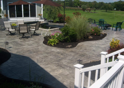Ashlar Slate Stamped Patio with Custom Pond and Flower Beds