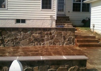 Ashlar Slate Stamped Patio with Masonry Walls