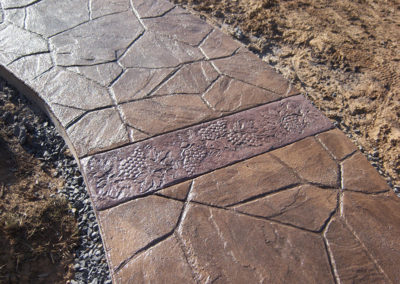 Broken Flagstone Stamped Concrete Walkway with Custom Grapevine Border
