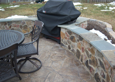 Broken Flagstone Stamped Patio with Masonry Wall