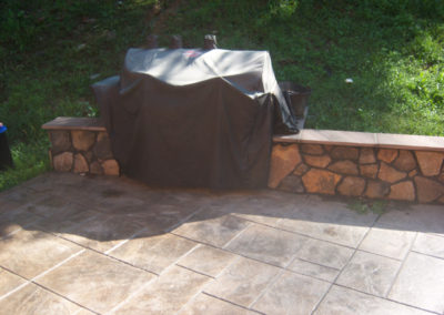 Slate Stamped Concrete Patio with Masonry Wall