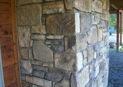 Stone Veneer Masonry Wall and Chimney